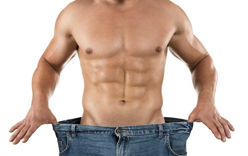 Weight-loss-close-up-of-muscular-built-man-wearing-too-large-jeans-isolated